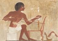 Un menuisier égyptien perce un meuble